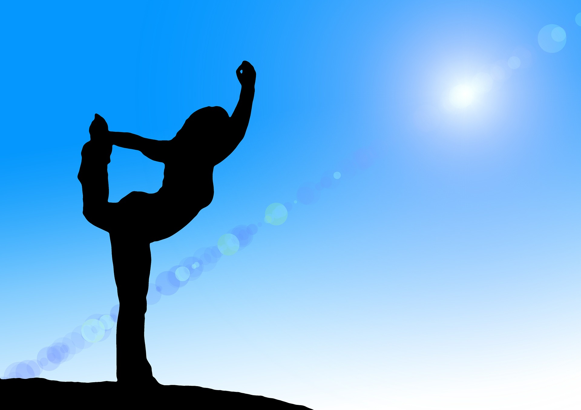 silhouette of a woman doing a yoga, blue screen background