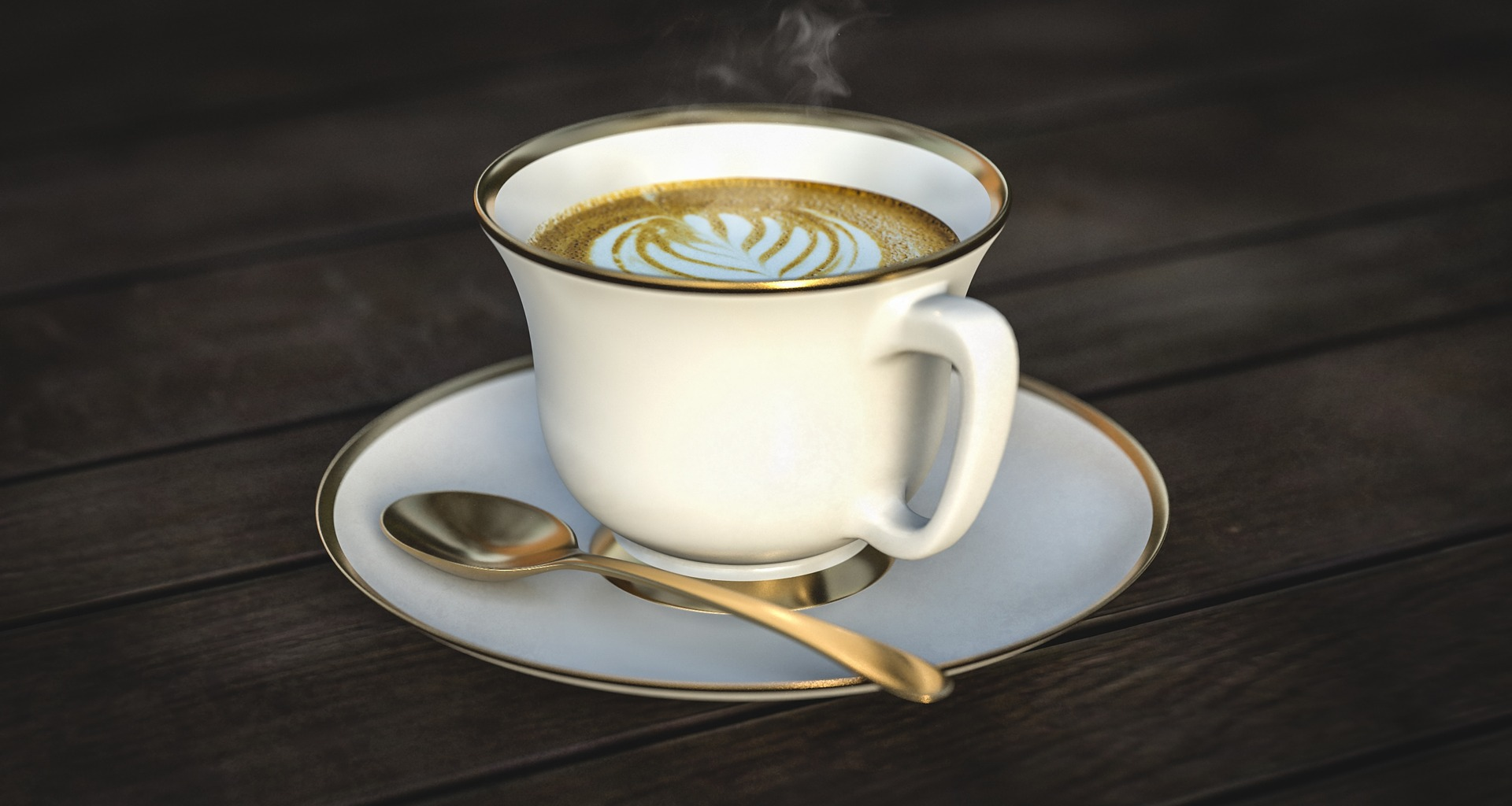a cappuccino in a white teacup with a saucer and spoon, pretty design in foam