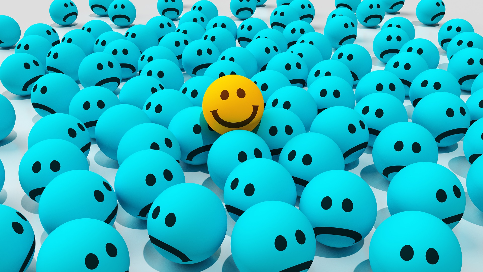 a bunch of blue frowny faces surrounding one yellow happy face