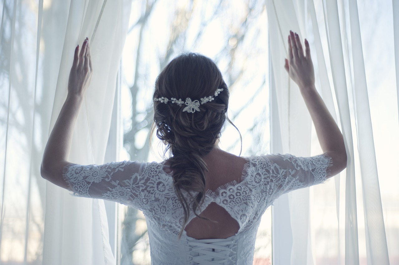 back of a bride looking out a window